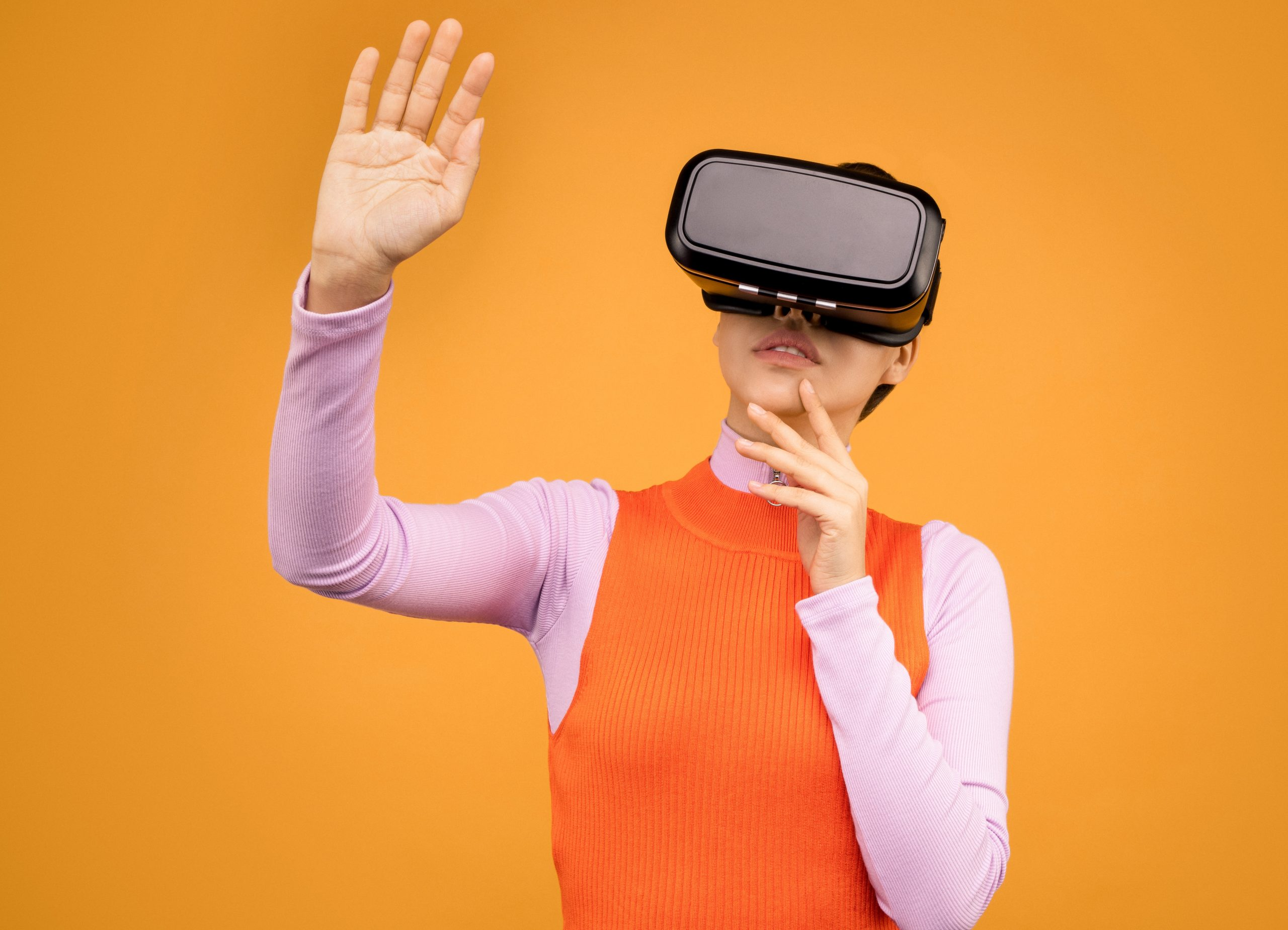 woman-in-long-sleeve-shirt-wearing-vr-goggles-3761304